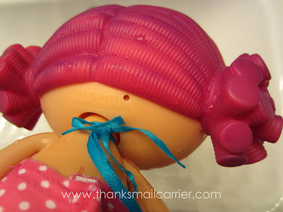 Lalaloopsy doll in water