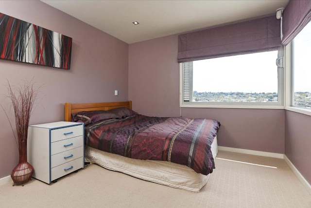 Photo of another bedroom with darker color and normal windows