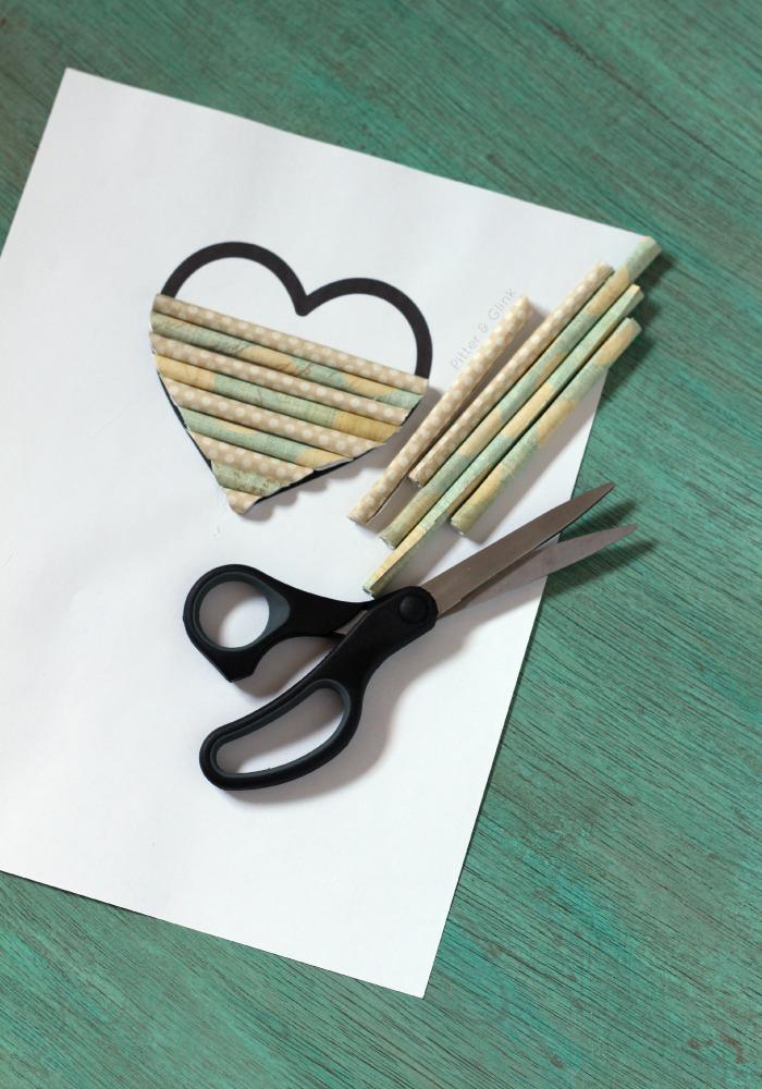 Scrap paper becomes a rolled paper heart.  pitterandglink.com