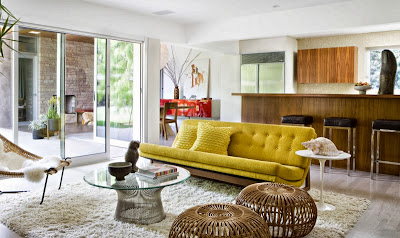 bright yellow sofa surrounded by more natural palette of materials