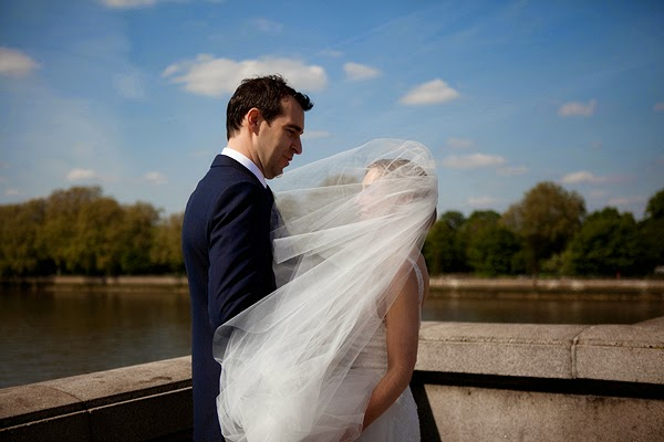 Bride and groom on the thames bridge London Wedding at All Saints Church in Fulham