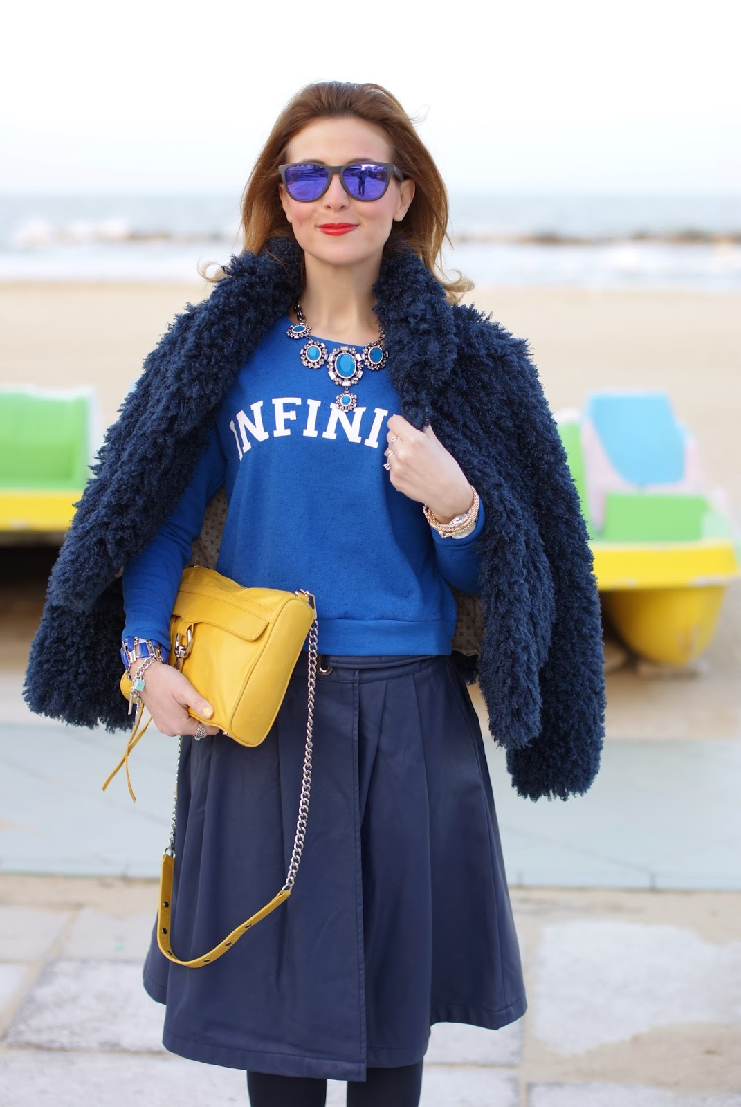 Blue faux fur jacket, Infinity sweatshirt, Oakley blue sunglasses, Fashion and Cookies, fashion blogger