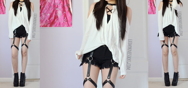 An edgy, grunge-rock outfit with the leather-trim choker-style cold shoulder SheIn top, a strappy bralette, Harajuku-style frayed harness shorts, and spiked high-heel booties.