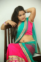 Anusha sizzling Pictures in half saree 064.JPG