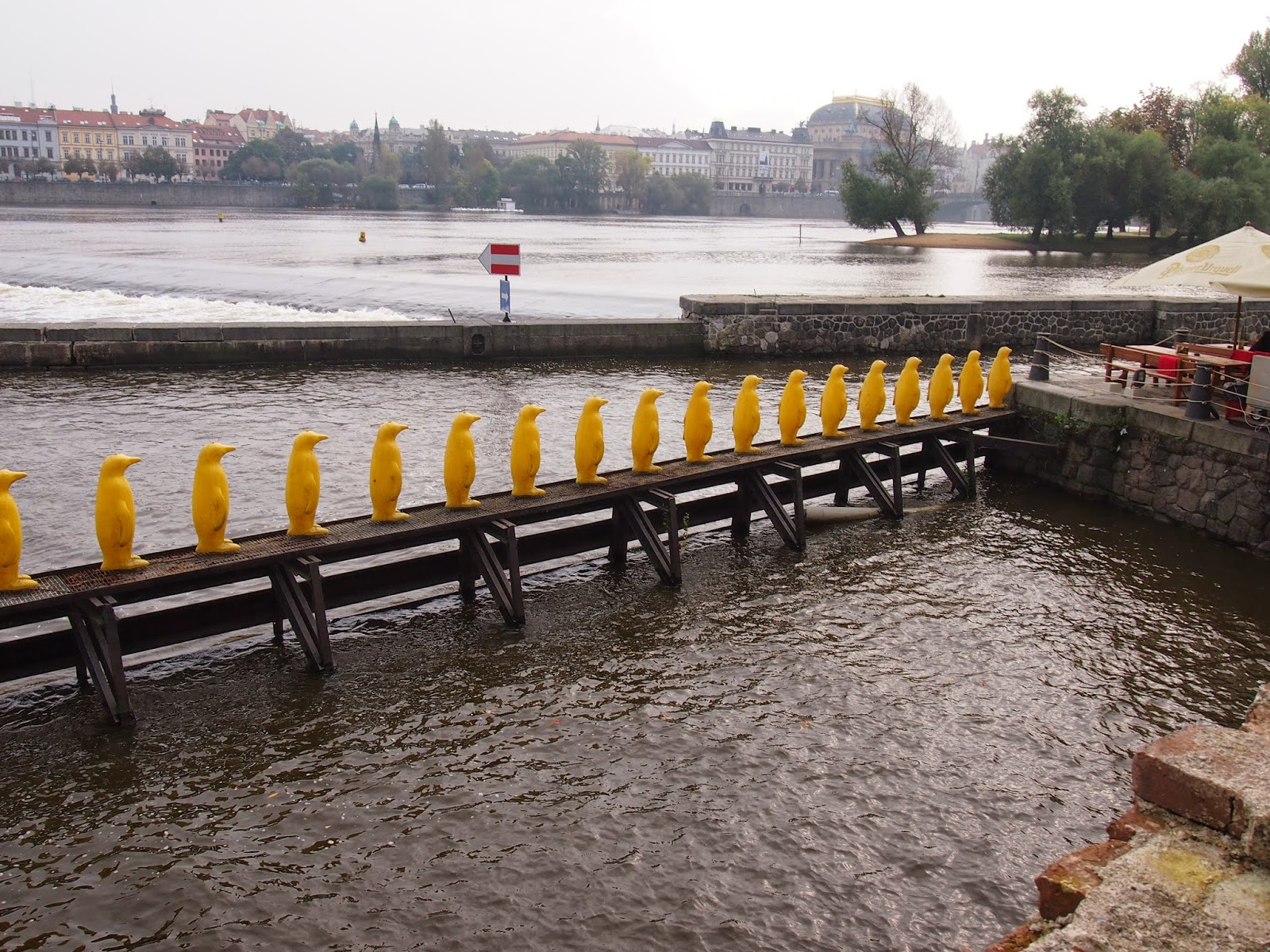 a row of yellow penguins in prague