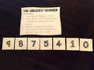 Use number cards to play a place value game