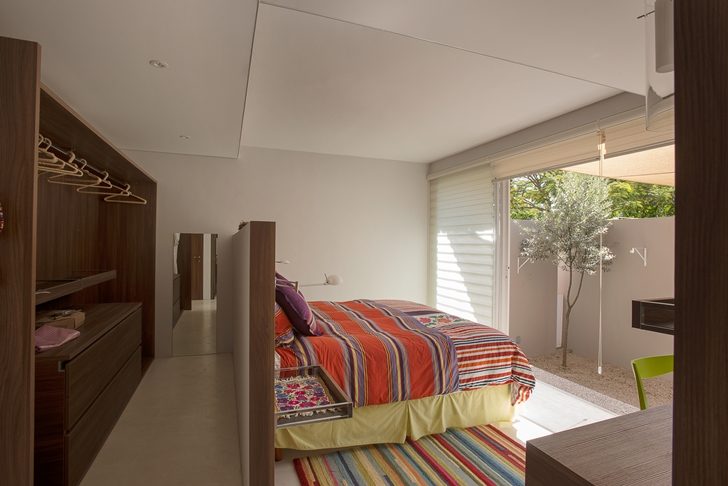 Bed in the bedroom of Casa del Viento by A-oo1 Taller de Arquitectura