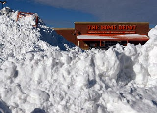 The Home Deport store behind a bank of snow post storm