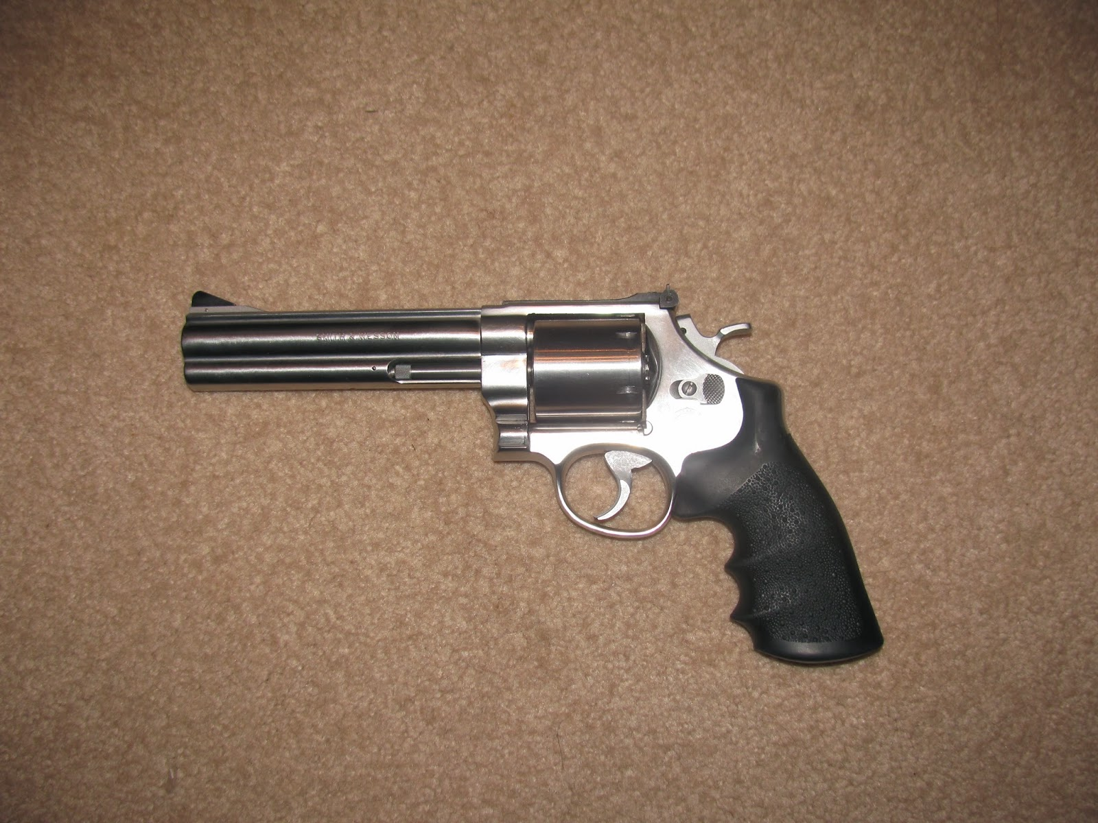 the 1st step in polishing a revolver like this is to remove the grips and look for scratches that you need to remove this gun had only two minor scratches