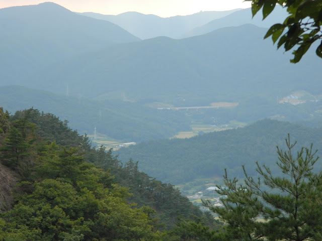 View of the valley below the mountains