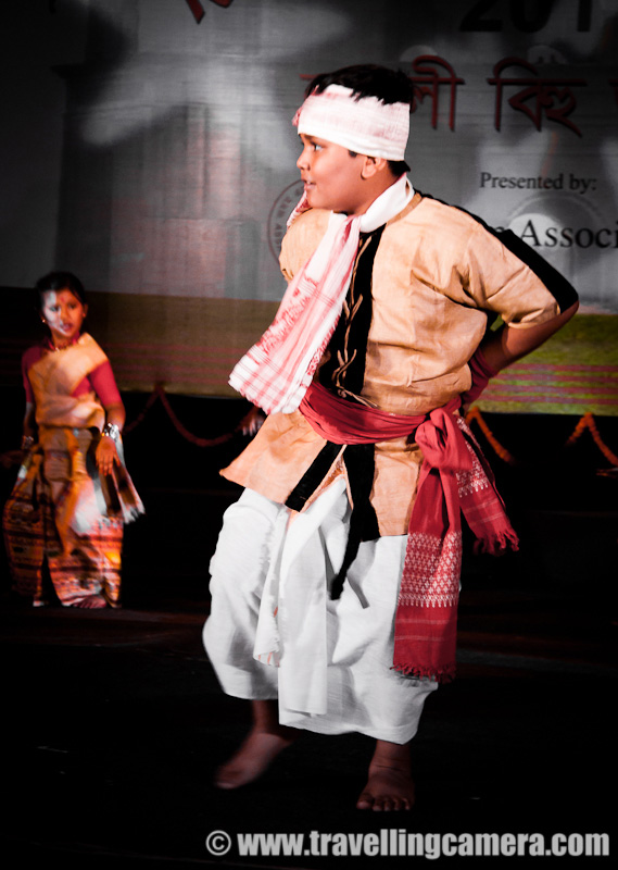 A Marvelous dance performance by troop of lovely school children on Bihu songs @ Rogali Bihu Festival at Indira Gandhi National Center of Art (24th April, 2011) : Posted by VJ SHARMA on www.travellingcamera.com : Recently I witnessed Rogali Bihu Festival at Indira Gandhi National Center of Art which was organized Assam Organization, Delhi !!! among various Bihu performances, these children presented a shining dance performance with cute expressions at each step... Check Out !!!Smallest girl in the troop and was leading one side of the sub-group on stage.. She was really enjoying dance with amazing expressions on her face and I assume expressions were changing as per the lyrics of the song !!! I am not sure because I could not understand Assamese...While other performances were going on the stage, these kids were roaming around the stage and it seemed that limit of their wait has crossed !!!Enthusiasm of all the kids was unmatchable and till the end they were like that only !!!If I am not missing anything, there were only two boys surrounded by all the girls !!! During the end part, a boy dressed up as old man entered and performance finished after some conversations between the lead person on the stage and the old man !!!These children look so pretty in Assamese sari's. This girl's smile reminds me of Vayjanthimala.Cute group of School children performing Bihu dance in sync @  Rongali Bihu Festival in Delhi, INDIA !!For such a sustained and consistent performance, these children would have had to go through several hours of practice. Kudos to them and their teachers for the achievement.Somehow synchronization is always a challenge with child dancers but that adds to the innocense of it all.Some steps were fairly complicated but the children were obviously enjoying themselves to the core.It was all done with the intention of having fun as well as performing for an audience.Saris were similar yet not the same. Some performers were obviously younger than the others. Yet age did not seem to make much difference to the quality of performances.Expressions were mature and could very well have been used in a drama. I don't know what the song was saying but it was easy to make out the gist from the expressions of these dancers cum actors.This seems to be a common step in this form of dance. Almost all performances included this.Highly enthusiastic and energetic performance by children. They were the life of the party.I hope these children keep performing and help in keeping the traditional dances alive. Preserving culture is very important. It is what gives each community its unique identity.