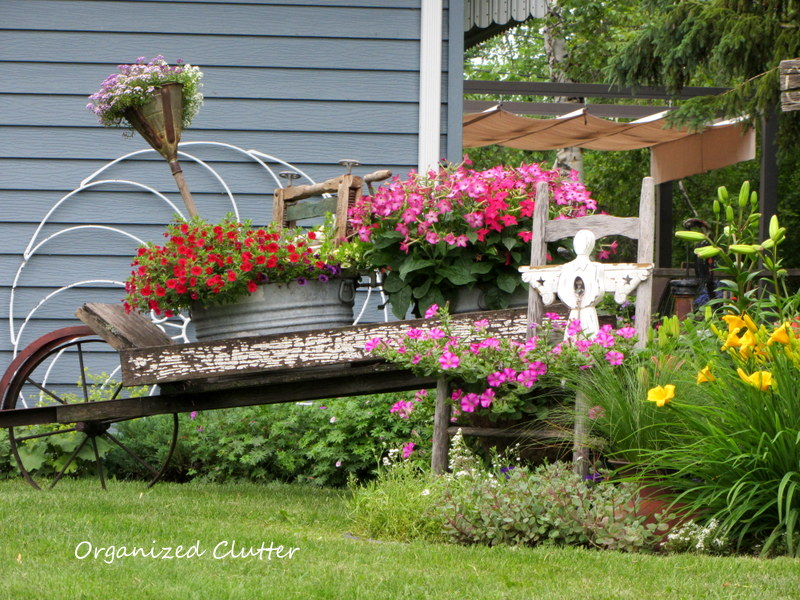 "Flower Garden Ideas With Old Wheelbarrow organized clutter: new ""wheelbarrow"" clipboard on hometalk"