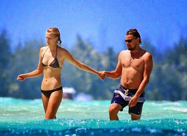Leonardo DiCaprio couldn't keep his hands off girlfriend Toni Garrn while sharing a romance moment in Miami on Friday, April 11, 2014 in Bora Bora.