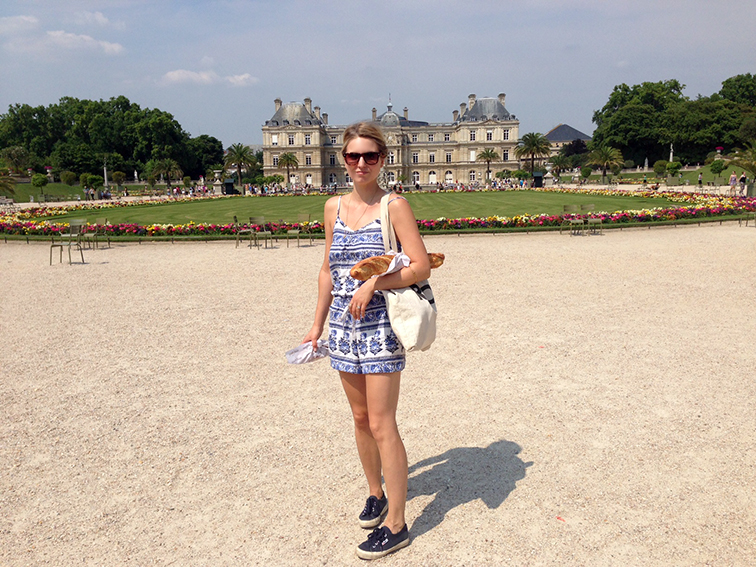 Fashion Over Reason at the Jardin du Luxembourg, LOFT floral linen romper, navy Superga sneakers, Suburban Riot canvas tote, Parisian moment with a baguette, summer style, fashion blogger