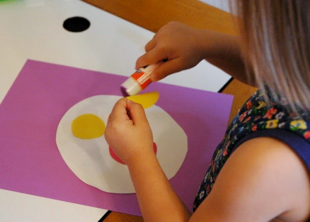 Gluing shapes to toddler circus craft
