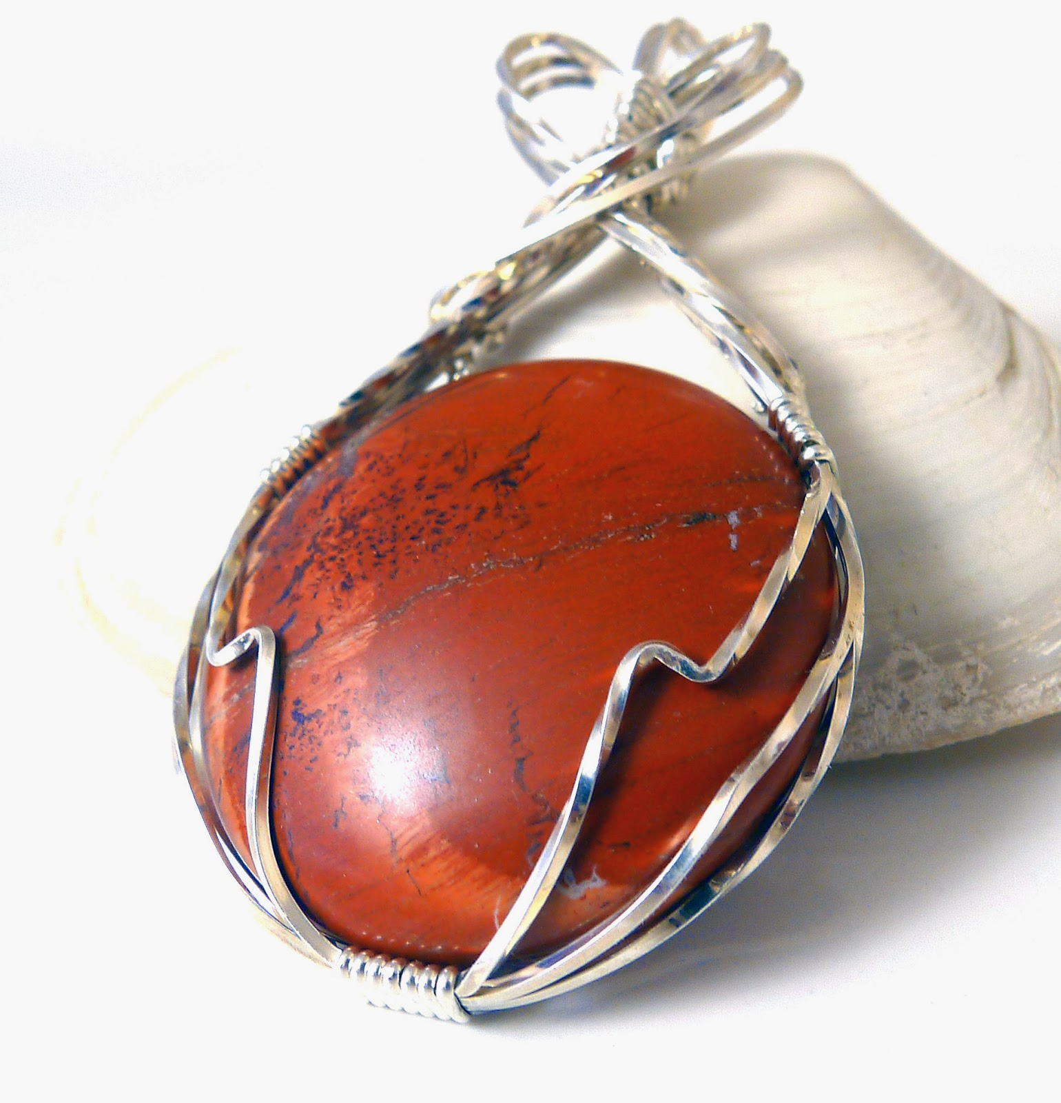 http://www.shazzabethcreations.co.nz/#!product/prd1/2467244481/red-poppy-jasper-and-sterling-pendant