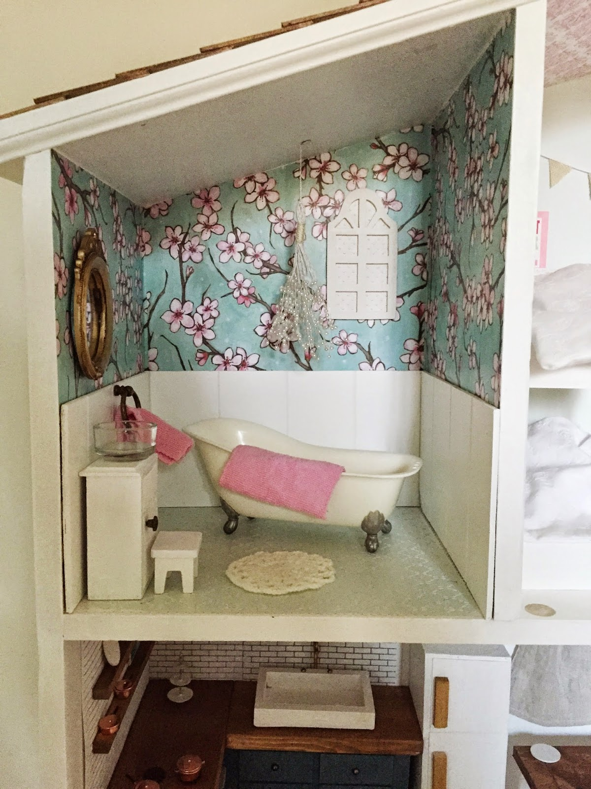 i modge podged the walls and the floors with scrapbook paper and then tim added the beadboard left over from our mudroom project to the walls barbie doll furniture diy