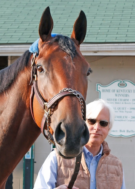 photo of american pharoah and his trainer bob baffert standing in front of the barns