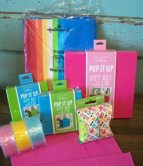 Tissue paper, box, and giftcard holders are just a few of the supplies for wrapping.