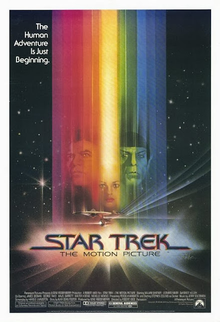 Movie Poster for Star Trek: The Motion Picture.  My earliest memory of a comic book is this image on the back cover.
