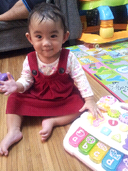 Lil Sofea wearing maroon gap pinafore
