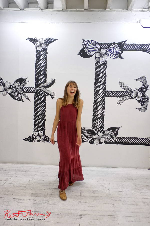 Candid 'stolen' portrait of Gemma O'Brien with Wall Work installation at China Heights Gallery - Photo by Kent Johnson.