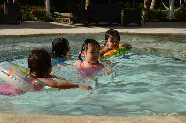 Four little girlst swimming