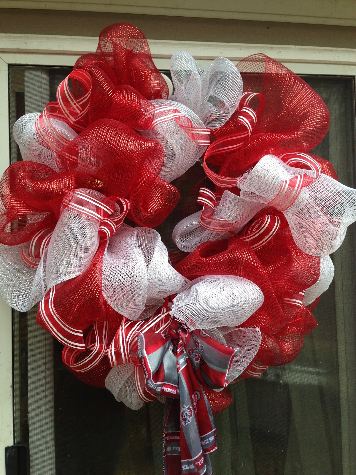 i hadnt planned on making this and osu wreath but the red and white was calling for a buckeye bow