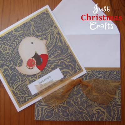 Handmade greeting card and matching envelope with festive bird theme