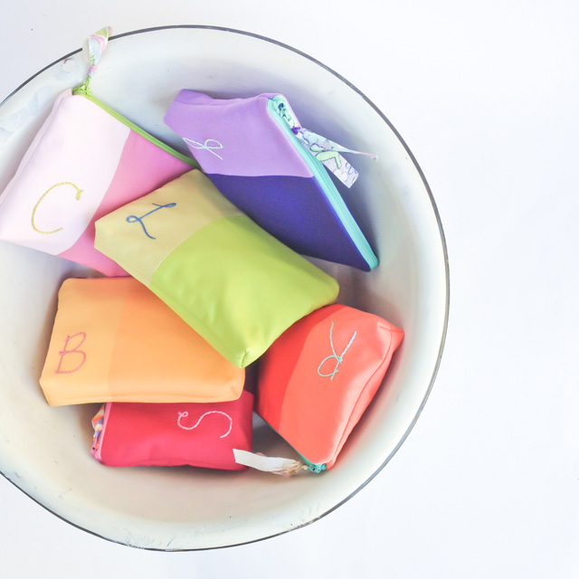 colorful monogrammed bridesmaid cosmetic bags   Mama Bleu Designs