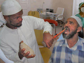 Arabic Indian doctor dentist primitive medieval methods chiseling a tooth out bad outdated