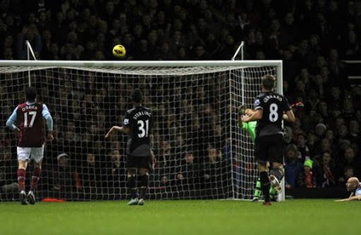 West Ham goalkeeper Jussi Jääskeläinen fails to stop a goal by Liverpool's Glen Johnson