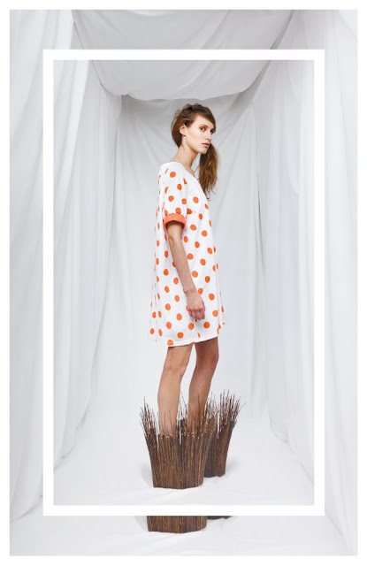 White dress with orange dots and wood