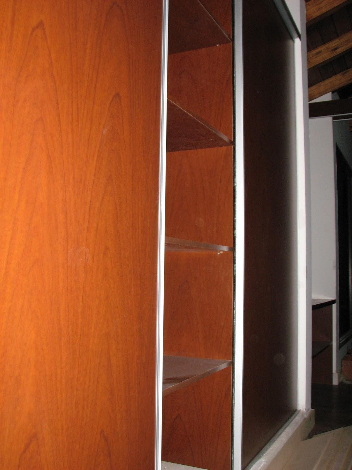 Cocinas y vestidores en mdf sistemas de puertas for Sistema para puertas corredizas