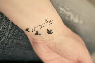 Beautiful Birds tattoos on hand