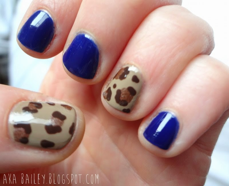 Navy nails with leopard print accent nails