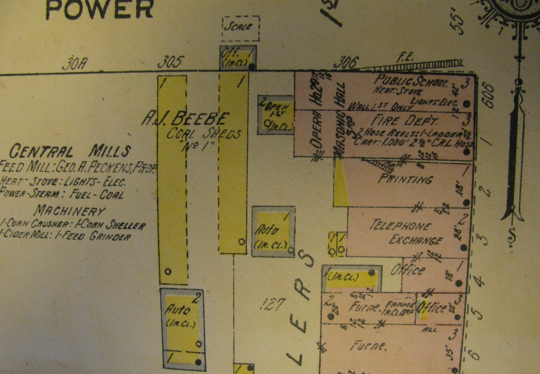 the portion of the map in pink at the upper right hand corner shows the fire department and public school rooms the white wooden schoolhouse had burned