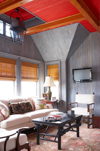 traditional living room design with wood wall panel and exposed red ceiling