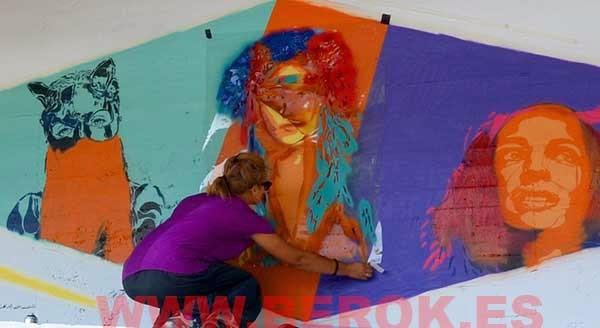 Btoy pintando su graffiti