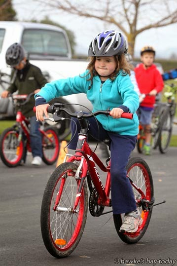 Georgie Hanna, 6, Hastings, practising controlled braking, at a BikeNZ Learn To Ride holiday programme at Hawke's Bay Regional Sports Park, Hastings, a one-day cycling programme for 6-10 year-olds, to develop their fundamental skills, confidence and enjoyment of cycling photograph