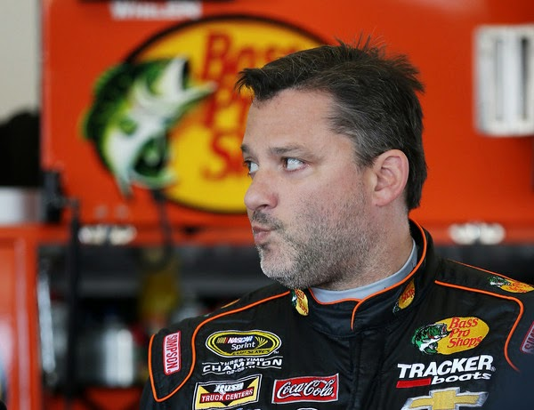 Tony Stewart, driver of the #14 Bass Pro Shops/Mobil 1 Chevrolet, stands in the garage area during practice for the 57th Annual Daytona 500 at Daytona International Speedway on February 14, 2015 in Daytona Beach, Florida. (February 13, 2015 - Source: Chris Graythen/Getty Images North America)