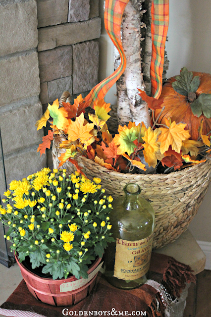 Fall mums and birch logs, part of Fall Mantel via www.goldenboysandme.com