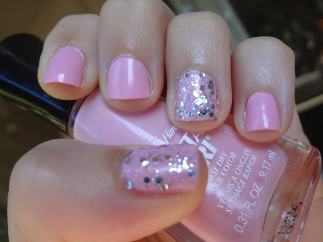 Pink Blink nail polish with silver glitter accent nails