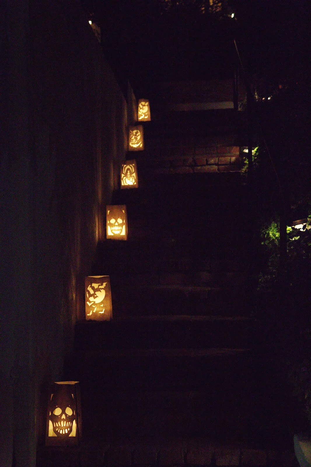 Luminarias lighting the pathway: Spooky Glam Halloween Party
