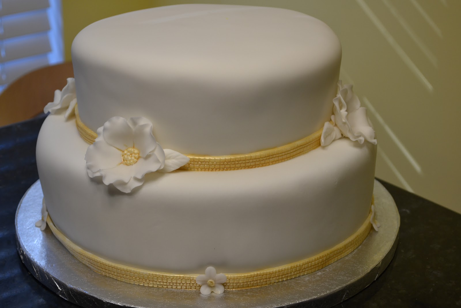 white and gold birthday cakes