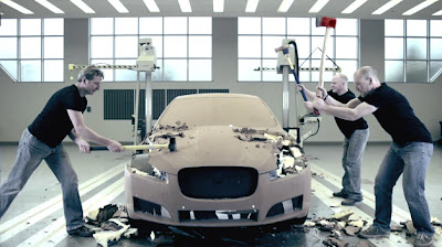Jaguar designers deconstruct XF clay model... with axes