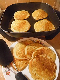 Plate of Golden Pancakes, with Four More on the Griddle