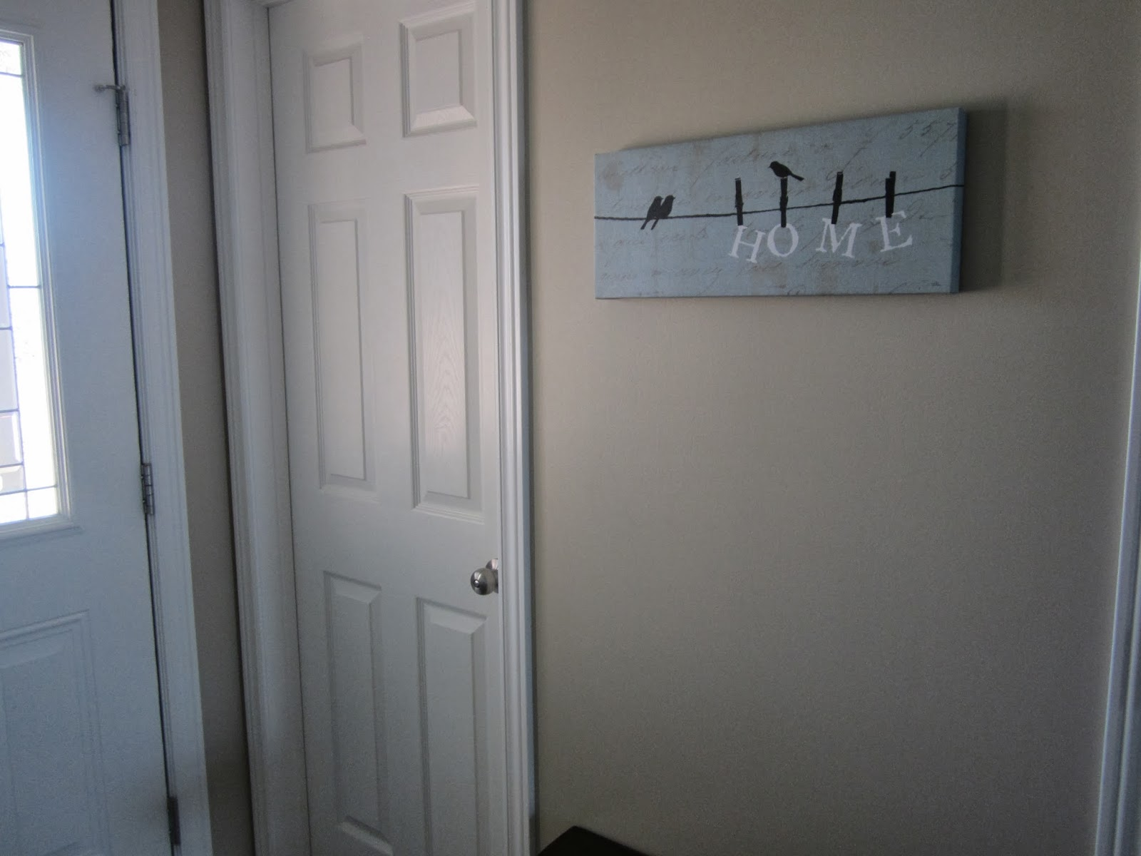 To the left of the entry is a small powder room and further on is the  title=