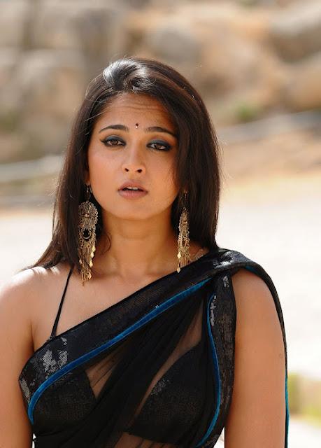Anushka Shetty Spicy Stills In Black Saree 10