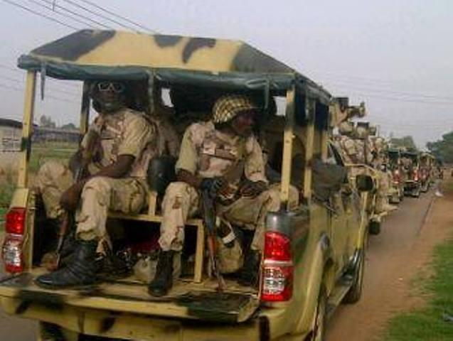 drunk nigerian soldiers beating
